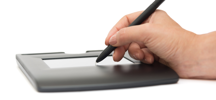 Man signing on digital signature pad